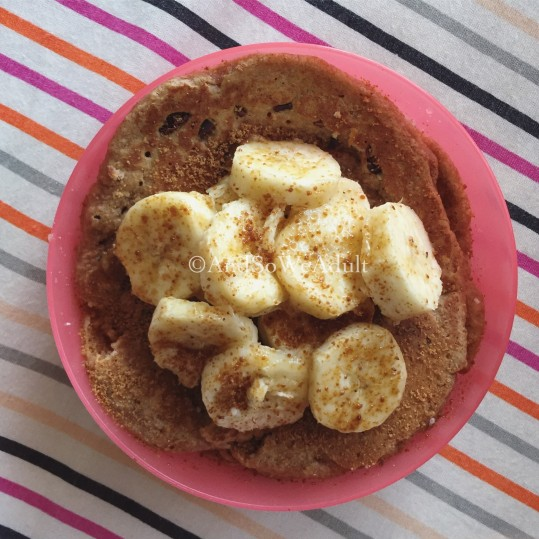 Spelt Flour Pancakes topped with bananas & coconut sugar